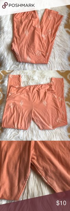 tall & curvy lularoe leggings orange with x marks lularoe leggings size TC. some wear in the crotch from being preowned but otherwise great condition. bundle wth other items for an even deeper discount. LuLaRoe Pants Leggings