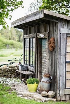 "A garden shed with an overhang. I like the galvanized steel element in this shed, complete with the ""industrial"" flair!"