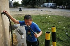 (AP) — In a trailer park tucked among irrigated orchards that help make California's San Joaquin Valley the richest farm region in the world, Giselle Alvarez, one of t Pollution Prevention, San Joaquin Valley, All About Water, Water Scarcity, Water Storage Tanks, Water Company, Environmental Issues, Water Systems, 16 Year Old