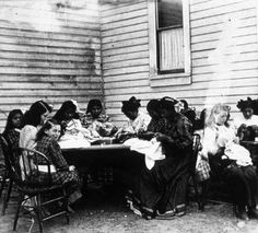 Colville girls doing hand sewing outdoors, St. Mary's Mission School, Omak, Washington :: American Indians of the Pacific Northwest -- Image...