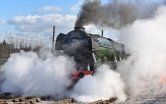 Train passengers caught an unexpected glimpse of the steam train, designed by Sir Nigel Gresley, as it thundered through stations on the East Coast mainline following its £4.2million revamp. The Flying Scotsman is pictured as it makes it way through York Station today