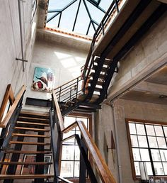 Walnut staircase and handrail of a loft | New York, USA | by Michael Haverland #DesignerBlog