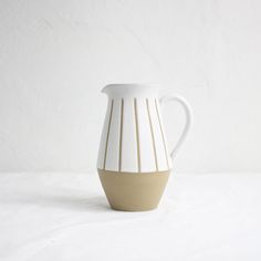 Beautifully simple vintage ceramic pitcher.