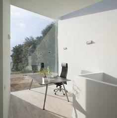 A Sculptural House Designed Around the Landscape Photo