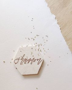 """61 Likes, 1 Comments - Nataline Putri (@natalineputri) on Instagram: """"Hexagon marble as place card? Why not? #weddingcalligraphy #balicalligraphy #weddingstationery…"""""""