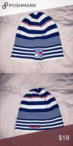 New York Rangers Beanie Striped red, white, and blue New York Rangers hockey team beanie. Never been worn. From the limited face-off collection by Reebok.   60% Cotton 40% Acrylic Reebok Accessories Hats