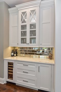 Hellyer Custom Builders new construction home in Naperville, Antique Mirror Glass Tile with Wine Cooler and Icemaker