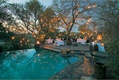 outdoor setting with lanterns and tiny white lights