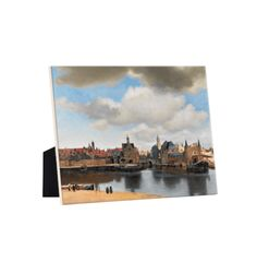View of Delft This is the most famous cityscape of the Dutch Golden Age. The interplay of light and shade, the impressive cloudy sky and the subtle reflections in the water make this painting an absolute masterpiece. We are looking at Delft from the south Delft, Johannes Vermeer, Dutch Golden Age, Rembrandt, Art Reproductions, Sky, Display, Ceramics, High Gloss