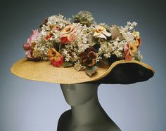 Woman's hat, ca. 1905 | American copy of a Paris model | Straw trimmed with silk velvet and artificial flowers | Philadelphia Museum of Art