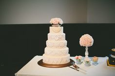 Antique lace-themed cake with teacup topper.