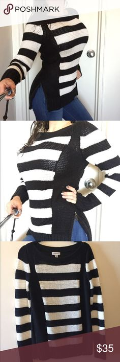 Gorgeous Calvin Klein striped sweater XS Gorgeous Calvin Klein striped sweater. Size XS. Black panels on sides for sliming effect. Zippers on sides for versatility. 77% acrylic 28% nylon. Very gently used. Like new condition. Calvin Klein Sweaters Crew & Scoop Necks