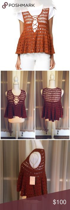 """Free People circles within circles sweater tank NWT Free People soft crocheted crop top with swingy, flirty silhouette. Lace up detailing at scoop neckline. Color is terracotta Size small, approximate flat measurements; length 19"""" width 16 1/2. Fabric: 82% cotton & 18% nylon. Offers warmly welcomed Free People Tops Crop Tops"""