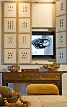 screen to hide your TV, several additional ideas to help a TV blend into a room at the link.