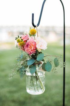 Pretty ceremony flowers: http://www.stylemepretty.com/2015/01/27/rustic-summer-wedding-by-the-sea/ | Photography: Wildflower Studio - http://www.wildflowerstudiophoto.com/