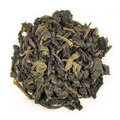 Tie Kuan Yin är världens mest berömda Oolong te. Den lätta fruktigheten balanseras med en aning rostad eftersmak.   Man får fram teet genom att rulla det i tyg som formas till små bollar. Genom processen får teet formen av små russin. Detta gör att teet håller sig friskt och fräscht längre och det kan ta upp till 3 bryggningar innan bladen helt slagit ut. Tie Kuan Yin kommer från Kina och kallas också för Guan Yin.