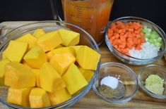 Pumpkin Soup Mise en Place three bowls with the raw ingredients for the soup and 4 cups of vegetable broth in a measuring cup