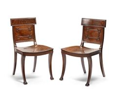 A pair of Regency mahogany hall chairs attributed to B. Harmer for Elward, Marsh & Tatham  (2)