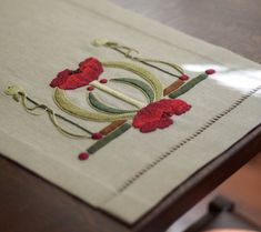 Beautiful embroidery - love the combo of sage green and red without looking too Christmasy.