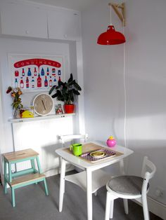 Bright, colour pop small space dining- we used compact IKEA PS stools alongside a vintage melamine table that we painted. We added overhead lighting using an IKEA Valter shelf bracket and light shade I picked up on a trip to New  York. Oh- and don't forget our DIY mint-painted BEKVAM stool!
