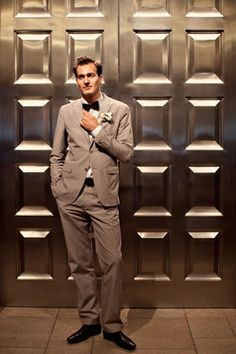 Groom with bowtie and grey suit