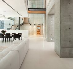 Epoxy coating in the living room. The bare white brings a chic vibe to the modern pad.