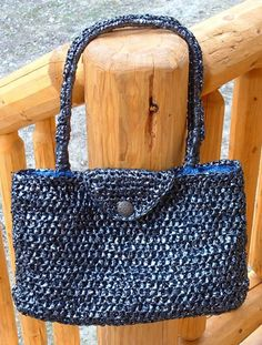 Mylar ribbons such as those from VHS/Betamax videos and from audio reel-to-reel/8-track/cassette tapes can be used to create chic items such as this stylish handbag. #crochet #patterns