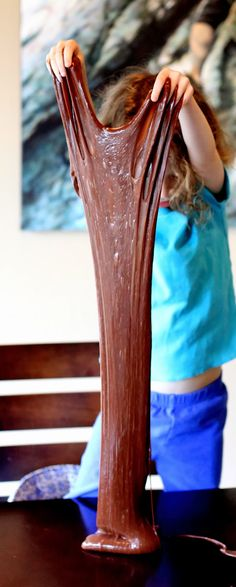 Chocolate Stretchy Slime Recipe from Fun at Home with Kids. Valentine themed sensory play