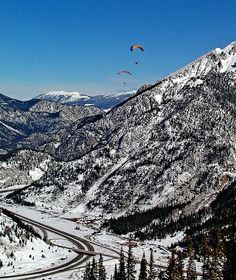 Paragliding over mountains by James Neeley