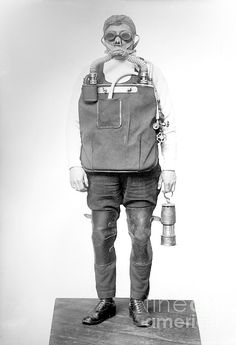 Mine rescuer. Man wearing a respirator device, goggles, and lamp, all designed for use during mine rescues. Dangers facing mine rescuers included toxic and flammable gases, as well as cave-ins and collapses. This photograph, which dates from the period 1910 to 1915, is from the Bain News Service, one of the USA's earliest news picture libraries.