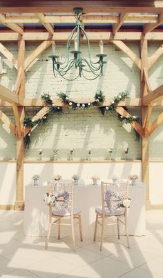 The orangery at Gaynes Park, ceremony flowers by Lily & May