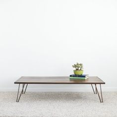 Hurley+Coffee+Table: Hurley+pairs+well+with+both+traditional+and+mid-century+decor,+thanks+to+his+neutral+wood+top+and+pin+legs.+He's+a+simple+guy+that+makes+a+huge+statement+in+any+seating+area.
