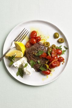 Every ingredient in this steak dinner, from the rosemary rub to the tomato and olive topping, is inspired by the Mediterranean diet.
