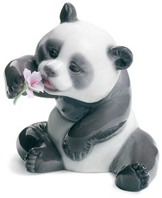 Lladro Collectible Figurine - Macy's - A cheerful panda trades his bamboo lunch in for a purple bloom in this irresistible Lladro collectible, handcrafted in fine porcelain.