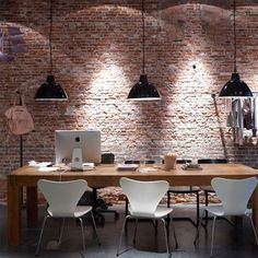 Great combination of pendant and ceiling lighting reflecting off open face brick work