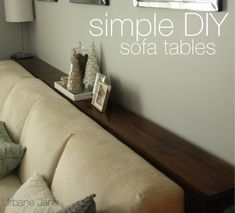 "urbane jane.: simple DIY sofa tables.   **Must remember to get couches without ""pillows"" behind my head and I love the narrow sofa tables."