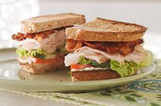 Garden-Style Club Sandwich recipe | Crunchy cucumbers and sliced tomatoes give these turkey breast and bacon sandwiches their garden-party style.