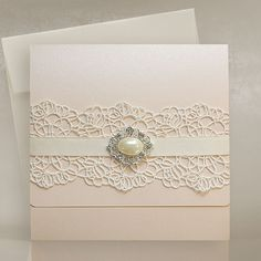 Blush Pink wedding invitations with lace and vintage brooch