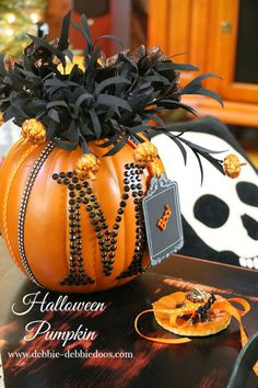 Faux pumpkins have never looked so fancy! Customize your jack-o'-lantern this year, and use it as a vase for fun accessories. Get the tutorial at Debbie Doo's. What you'll need: hot knife ($20; amazon.com), letters ($13; michaels.com), black flowers ($7; amazon.com), Halloween ribbon ($15; amazon.com)