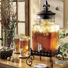 """Shop here: www.athome.com/donita At Home French Market 5-Quart Beverage Dispenser   Inspired by the timeless elegance of 18th century France, our handcrafted dispenser makes it easy to add a bit of luxury to your home. 8""""dia. x 141⁄4""""h; Stand: 81⁄4""""dia. x 43⁄4""""h $69.99"""