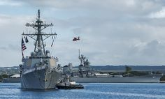The guided-missile destroyer USS Paul Hamilton (DDG 60) passes by USS Missouri memorial as it returns to its homeport of Joint Base Pearl Harbor-Hickam following a nine-month deployment. The ship is flying a 242-foot Homeward Bound Pennant; the length of the pennant is one foot for each Sailor on the ship who has served on board while overseas in excess of nine months. (U.S. Navy photo by MC3 Diana Quinlan)