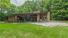 Designed by Frank Lloyd Wright's Master Builder Harold Turner, this house, built in blends its natural materials into its lush… Village House Design, Village Houses, Bloomfield Hills, Organic Architecture, Backyard, Patio, Midcentury Modern, Exterior Design, Landscape Design