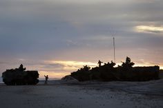 U.S. Marines with Alpha Company, 2nd Assault Amphibious Battalion, 2nd Marine Division, stage Assault Amphibious Vehicle P7A1's before conducting another splash entry during a training exercise at Onslow Beach aboard Camp Lejeune, N.C., Jan. 9, 2014. The training exercise was conducted to practice beach raids for future ship to shore operations. (U.S. Marine Corps photo by Lance Cpl. Christopher Mendoza/Released)