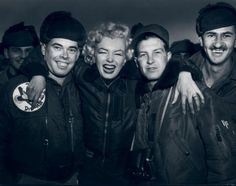 A rare picture of Marilyn with some of the troops in Korea, February 1954.