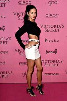Pin for Later: 25 Supersexy Outfits We Probably Wouldn't Let Our Mums Wear Adriana Lima Clearly Has Nothing to Hide in This Racy Little Design Is it a top and skirt? Is it a dress? Is it clothes?