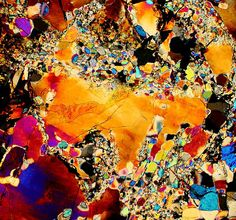 Description:  This is a photograph of the Vaca Muerta meteorite. This is a photo of a thin section of this meteorite viewed through a microscope using transmitted cross polarized light. The different colors indicate the mineral and crystal composition of this meteorite.
