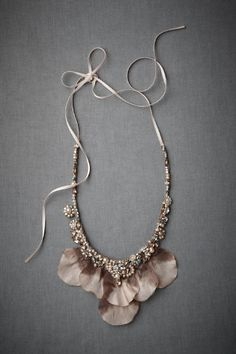 Unfurled Iris Necklace ~ Ombre petals open up beneath a decadently studded collar, while slender ribbons tie at your nape.
