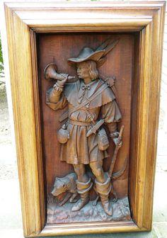 Hunter, carved panel