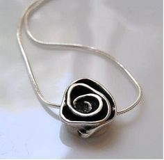 Metal Flower On Sterling Silver Necklace