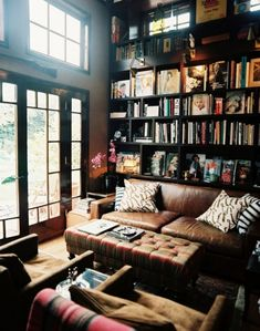 Bookshelves and weathered leather couch look like they could use some company-and some wine.